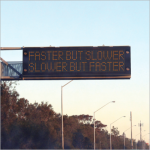 Road sign saying faster but slower slower but faster