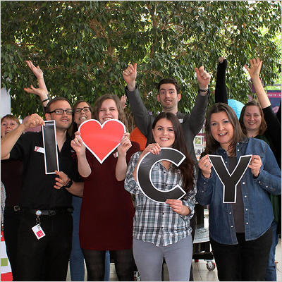 Courtyard staff with I Heart CY sign