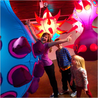 Children interacting with Generation AIR exhibition