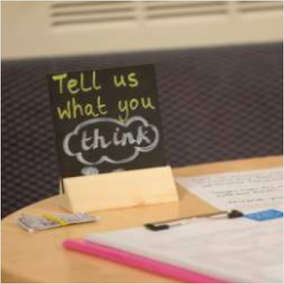 Sign saying Tell us what you think