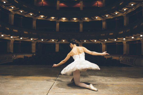 Ballerina in an empty theater