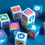 A paper cubes printed logos of social networks and online messengers, such as Facebook, Instagram, YouTube, etc
