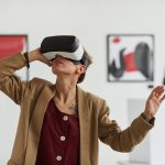 Woman Wearing VR headset in art gellery