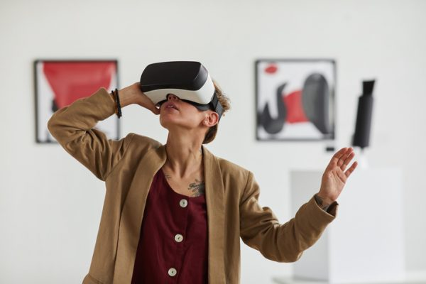 Woman Wearing VR headset in art gellery