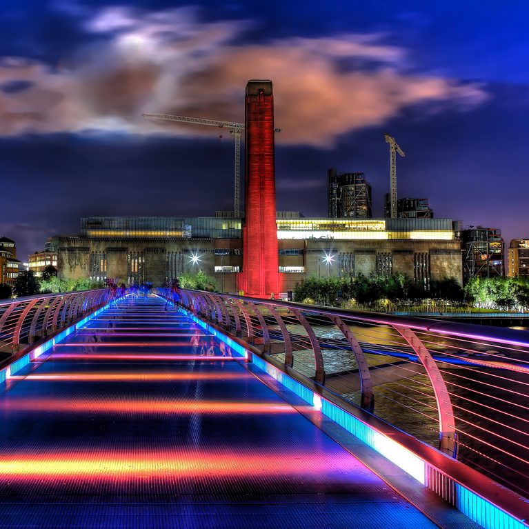 Lights across the Millennium Bridge towards Tate Modern at night.
