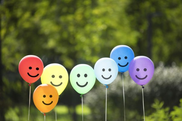 Group of balloons with smiley faces