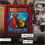 Photo with Red Cow sign
