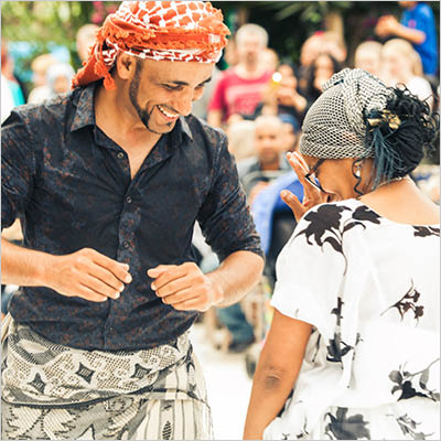 Performer and audience member dance at LAAF Family Day