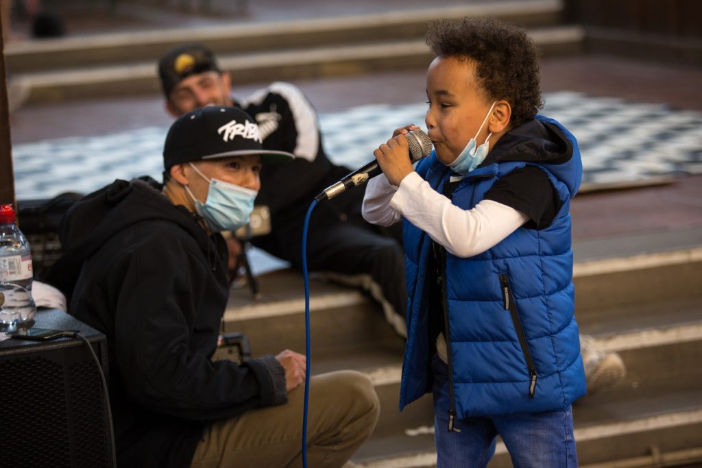 Small boy singing down microphone
