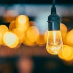 A lightbulb gives off a warm yellow glow