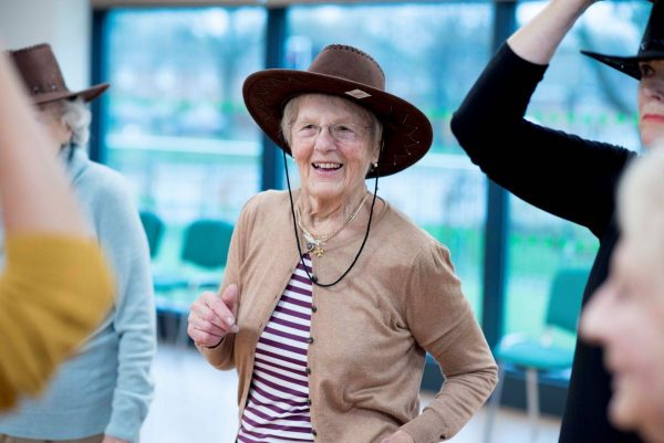 Older woman in hat dancing