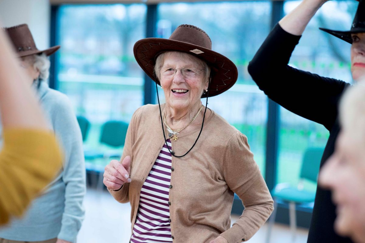 Older woman in hat dancing