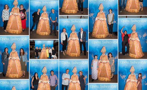People pose with a character from an opera to have their photo taken.