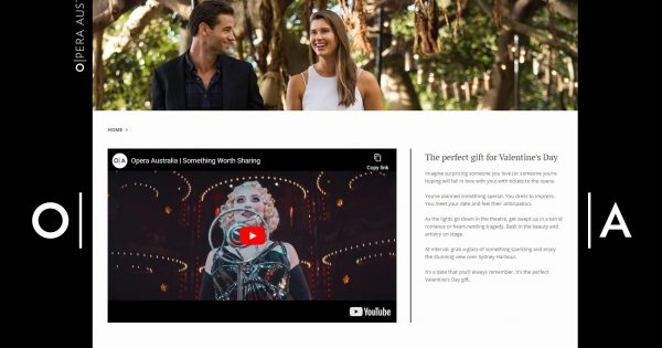 Valentine's day promotion showing a smiling, happy couple walking through a wood with a video insert of an opera.