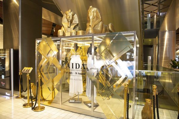 A large display of costumes and props from Aida including two large golden Sphinx. The display is in a shopping centre.