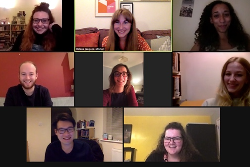 Eight smiling people on a Zoom call