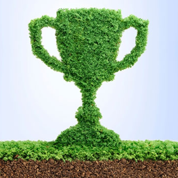 A giantic green, two-handled award cup topiary.