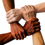 4 hands with a variety of skin tones grasp each others wrists
