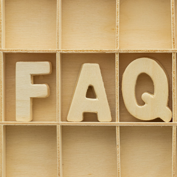 3 Wooden letters each in a sperate compartment in a wooden box spelling FAQ