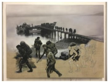 Soldierswalk across a jetty and onto the beach