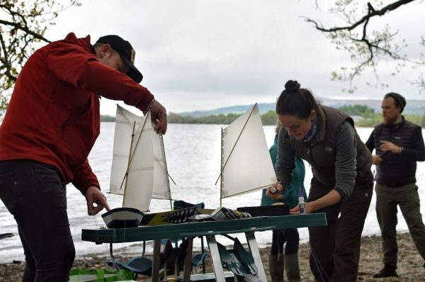 People making sails for miniature boats