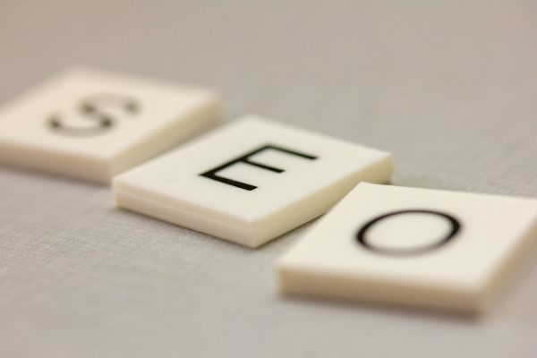 Scrabble letters spell out S-E-O