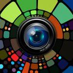A camera lens radiating a kaleidoscope of colours